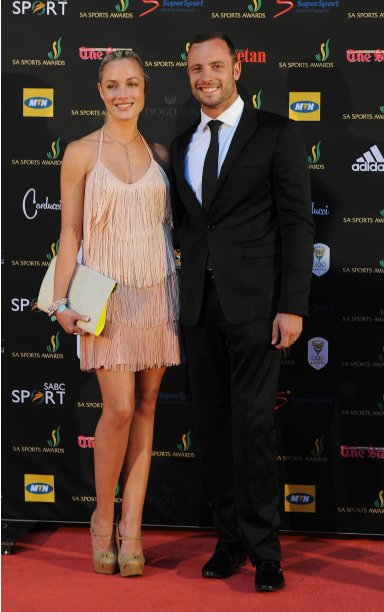 "South African ""Blade Runner"" Oscar Pistorius (R) poses with his girlfriend, model Reeva Steenkamp at an awards ceremony in Johannesburg"