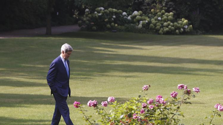 U.S. Secretary of State John Kerry walks in the garden of the U.S. ambassador's residence before he meets with Turkish Foreign Minister Ahmet Davutoglu in Paris, France, Saturday, July 26, 2014. With a 12-hour humanitarian cease-fire in Gaza Saturday, Kerry is continuing with efforts to reach a longer truce between Israel and Hamas. (AP Photo/Charles Dharapak, Pool)