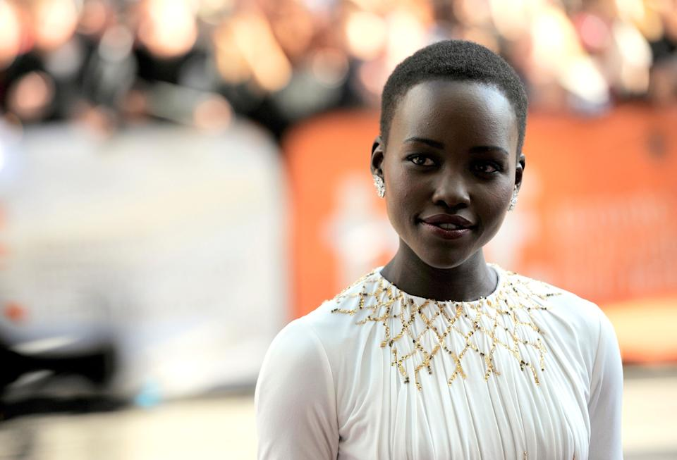 "Lupita Nyong'o arrives at the premiere for ""12 Years a Slave"" on day 2 of the Toronto International Film Festival at The Princess of Wales Theatre on Friday, Sept. 6, 2013, in Toronto. (Photo by Chris Pizzelloi/Invision/AP)"