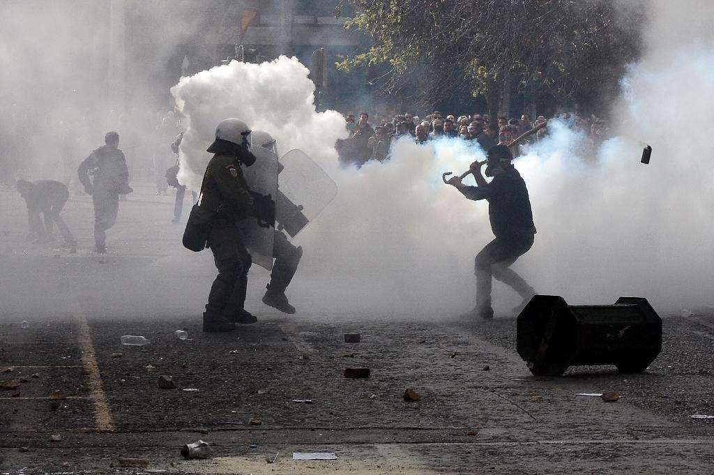 Greek farmers clash with police during mass protest in Athens