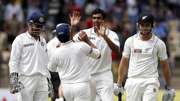 India&#39;s Ravichandran Ashwin (2nd R) celebrates taking the wicket of New Zealand&#39;s Daniel Flynn (R) with team-mates (Reuters)