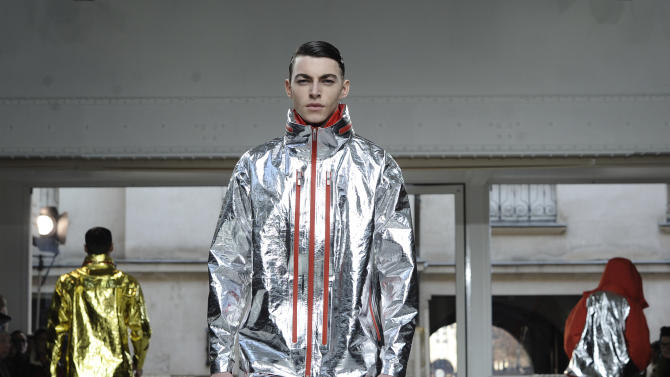Models present creations for Issey Miyake fall-winter 2013/2014 men's fashion collection, presented in Paris, Thursday, Jan.17, 2013. (AP Photo/Zacharie Scheurer)