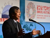 Yi Gang, deputy governor of the People's Bank of China, speaks at a seminar at the International Monetary Fund and World Bank Group annual meeting in Tokyo on October 14. Yi said Sunday his top priority is to control inflation, despite calls by developed economies to chase growth