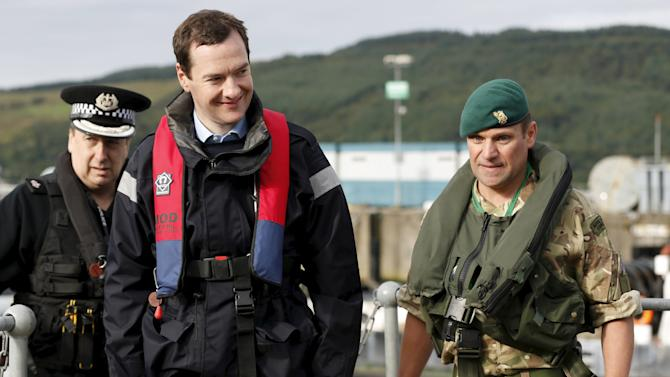 Britain's Chancellor of the Exchequer Osborne arrives at the jetty of the Royal Navy's submarine base at Faslane