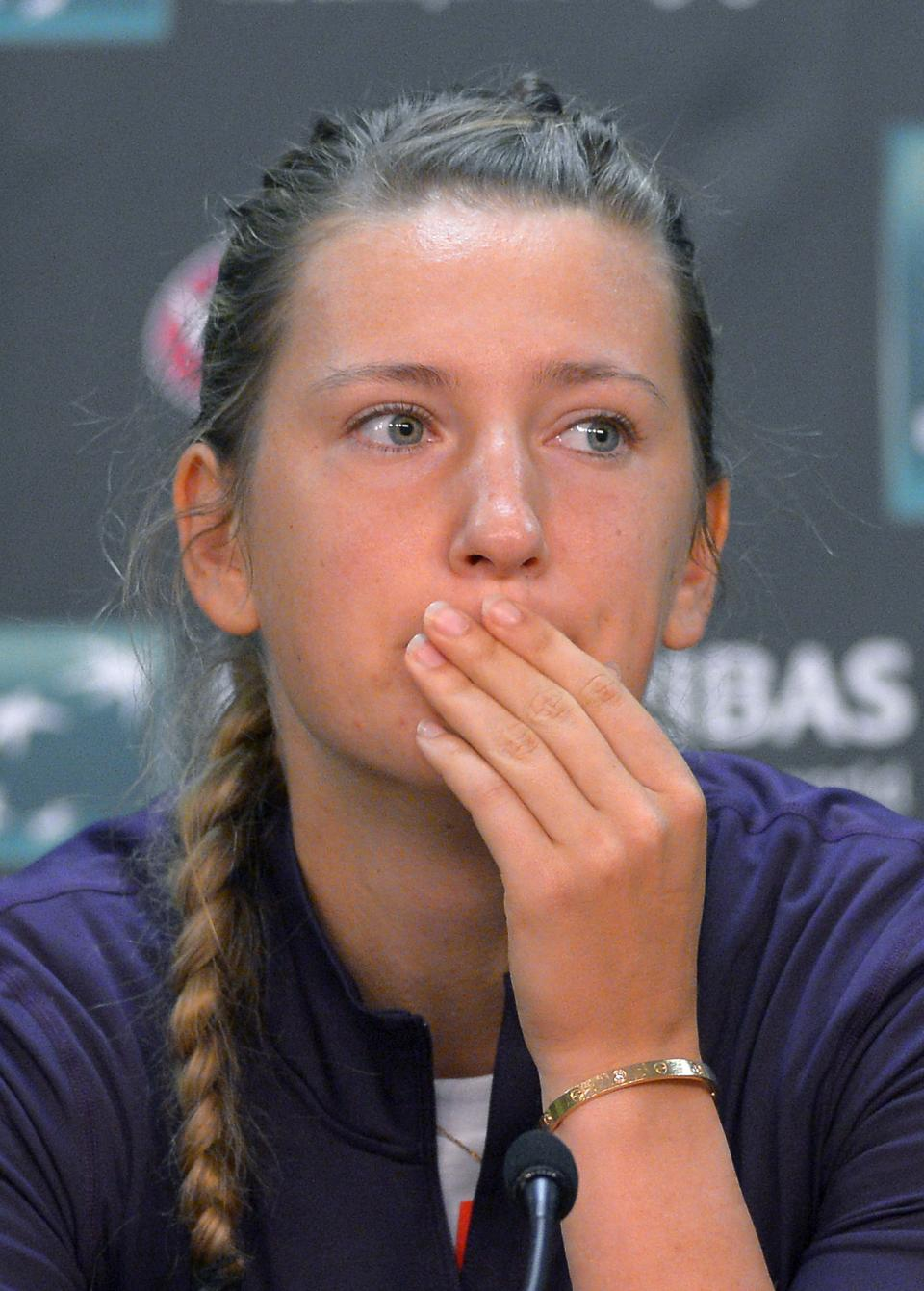 Victoria Azarenka, of Belarus, listens during a news conference to announce that she had withdrawn from the BNP Paribas Open tennis tournament due to an ankle injury, Thursday, March 14, 2013, in Indian Wells, Calif. (AP Photo/Mark J. Terrill)