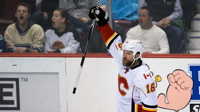 Calgary Flames' Brian McGrattan celebrates his goal against the Vancouver Canucks during the second period of an NHL hockey game, Saturday, March 8, 2014 in Vancouver, British Columbia