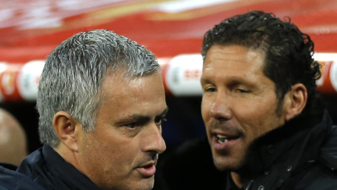 Real Madrid's coach Jose Mourinho from Portugal, left, talks with Atletico's coach Diego Simeone from Argentina, right, at the players bench before the start of the Copa del Rey final soccer match between Atletico de Madrid and Real Madrid at the Santiago Bernabeu stadium in Madrid, Spain, Friday, May 17, 2013. (AP Photo/Daniel Ochoa de Olza)
