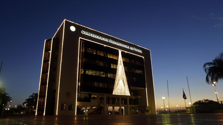 The headquarters of the South American Football Confederation (CONMEBOL) is seen lit up for Christmas and New Year celebrations in Luque