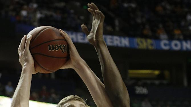 Florida forward/center Erik Murphy (33) heads to the basket as Alabama guard Rodney Cooper (21) defends during the first half of an NCAA college basketball game at the Southeastern Conference tournament, Saturday, March 16, 2013, in Nashville, Tenn. (AP Photo/Dave Martin)