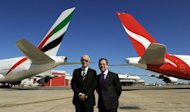 Qantas chief Alan Joyce (R) and Emirates president Tim Clark pose at Sydney Airport. Qantas on Thursday announced a major global alliance with Emirates that will see its hub for European flights shift to Dubai from Singapore in a bid to stem losses