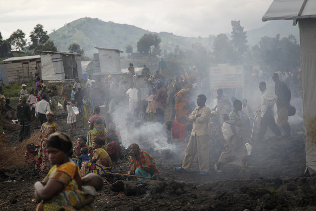 Internally displaced Congolese gather at the Mugunga 3 camp west of Goma, eastern Congo, Monday Nov. 26, 2012. Regional leaders meeting in Uganda called for an end to the advance by M23 rebels toward Congo's capital, and also urged the Congolese government to sit down with rebel leaders as residents fled some towns for fear of more fighting between the rebels and army. (AP Photo/Jerome Delay)