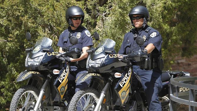 University Police on motorcycles stand watch at the University of Colorado in Boulder, Colo., on Friday, April 20, 2012. The university closed the campus to prohibit an annual 420 marijuana smoke out. (AP Photo/Ed Andrieski)