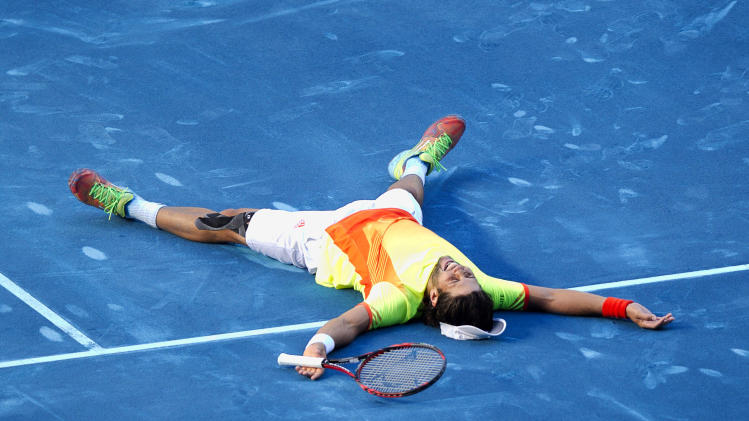Spain's Fernando Verdasco celebrates after defeating Rafael Nadal during the Madrid Open tennis tournament, in Madrid, Thursday, May 10, 2012. (AP Photo/Daniel Ochoa de Olza)