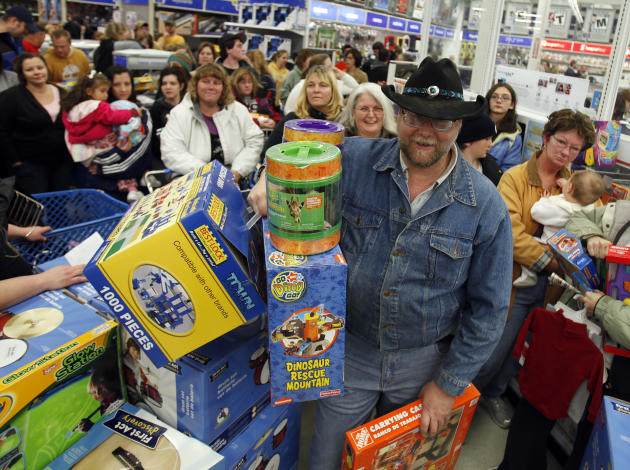 "Shoppers wait in line at Toys ""R"" Us on Black Friday."