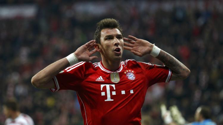 Bayern Munich's Mandzukic celebrates scoring goal against 1.FC Kaiserslautern during their German soccer cup semi-final match in Munich