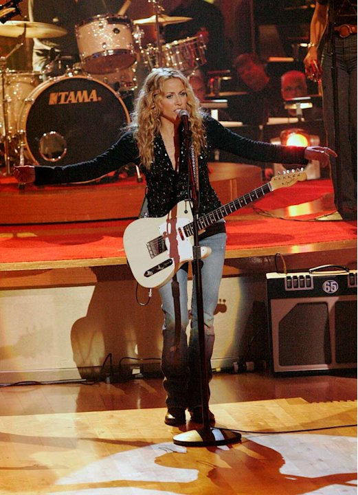 Sheryl Crow performs on the 6th season of Dancing with the Stars. Adam Carolla