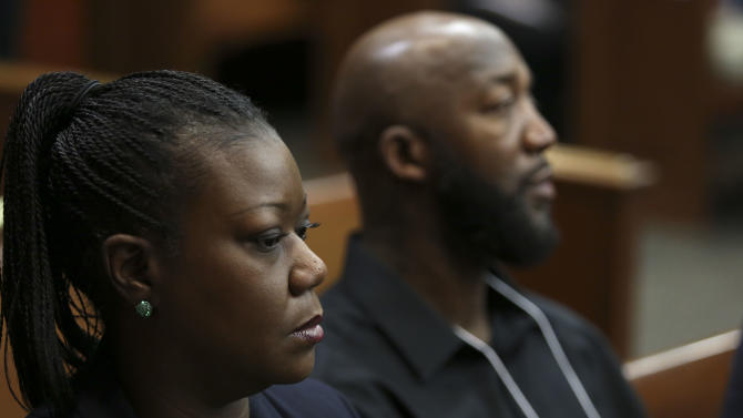 Tracy Martin, right, and Sybrina Fulton, parents of Trayvon Martin, watch during the final stages of jury selection in the trial of George Zimmerman in Seminole circuit court in Sanford, Fla., Thursday, June 20, 2013. Zimmerman has been charged with second-degree murder for the 2012 shooting death of Trayvon Martin.(AP Photo/Orlando Sentinel, Gary Green, Pool)