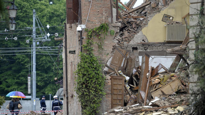 Residents wander outside a collapsed church in San Felice sul Panaro, northern Italy, Sunday, May 20 2012. A magnitude-6 earthquake shook northern Italy early Sunday at 4:04 a.m. between Modena and Mantova, about 35 kilometers (22 miles) north of Bologna at a relatively shallow depth of 10 kilometers (6 miles). (AP Photo/Marco Vasini)