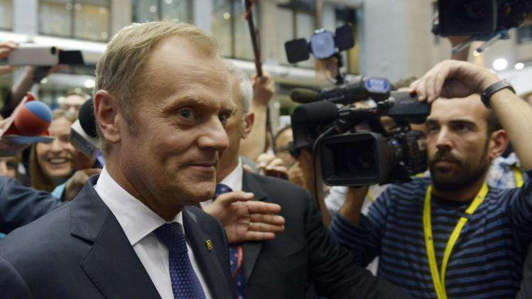 Poland's Prime Minister Tusk walks on his way to a news conference during an EU summit in Brussels