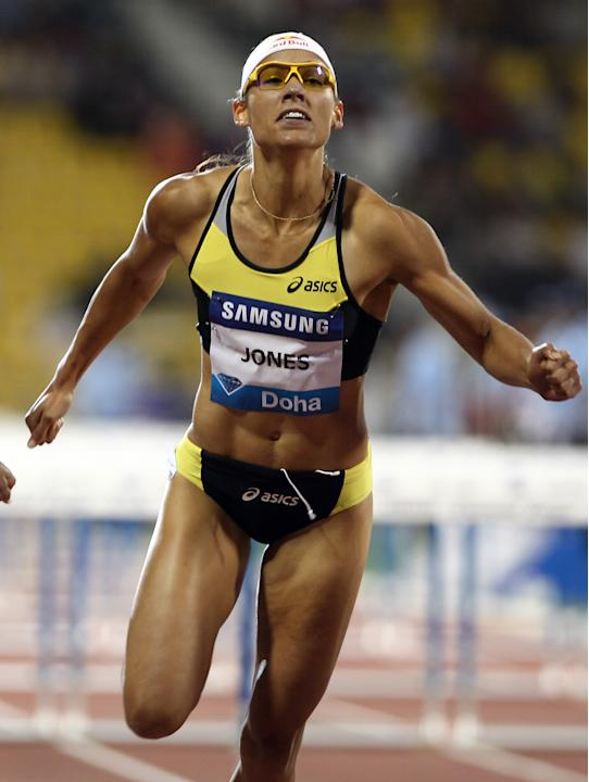 Lolo Jones of the US competes in the women's 100m hurdles at the IAAF Diamond League in Doha on May 6, 2011.(AP Photo/osama faisal )