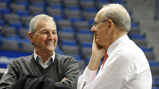 Former Connecticut head coach Jim Calhoun, left, speaks with Syracuse head coach Jim Boeheim before an NCAA college basketball game between the two teams in Hartford, Conn., Wednesday, Feb. 13, 2013. (AP Photo/Jessica Hill)