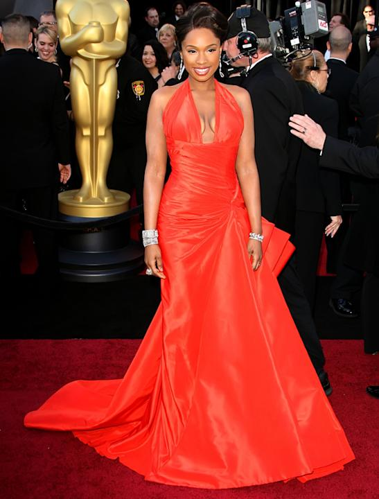 Oscars 2011 photos: Jennifer Hudson was the lady in red thanks to this halter neck Atelier Versace dress.
