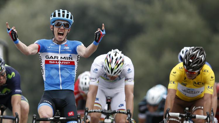 Garmin team rider Tom Jelte Slagter of Netherlands celebrates winning the seventh stage of Paris-Nice cycling race