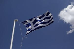 Greek national flag flutters atop Lycabetus hill in…