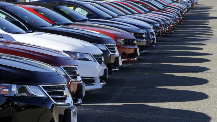 In this Wednesday, Sept. 18, 2013 photo Chevrolet passenger cars form a row on a dealer's lot in Needham, Mass. U.S. auto sales for September are released on Tuesday, Oct. 1, 2013. (AP Photo/Steven Senne_