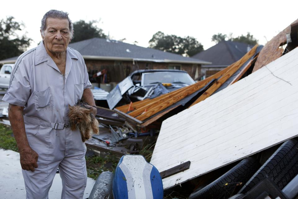 Raymond Pierce, 72, surveys damage to his property after strong winds from a suspected tornado passed through the Lafayette Woods subdivision Wednesday, Nov. 16, 2011  in Houma, La.  No one was injured. (AP Photo/The Houma Courier, Julia Rendleman)
