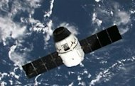 This frame grab from a NASA video shows the SpaceX Dragon capsule near the ISS before linking to the station&#39;s Harmony module on May 25. The Dragon became the first privately owned spacecraft to berth with the ISS
