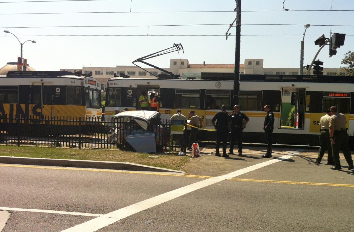 Los Angeles train hits car on tracks and derails, 21 hurt