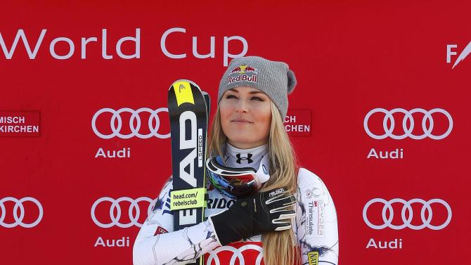 First placed Vonn of the U.S. reacts on the podium after competing in the Alpine Skiing World Cup women's downhill race in the Bavarian ski resort of Garmisch-Partenkirchen