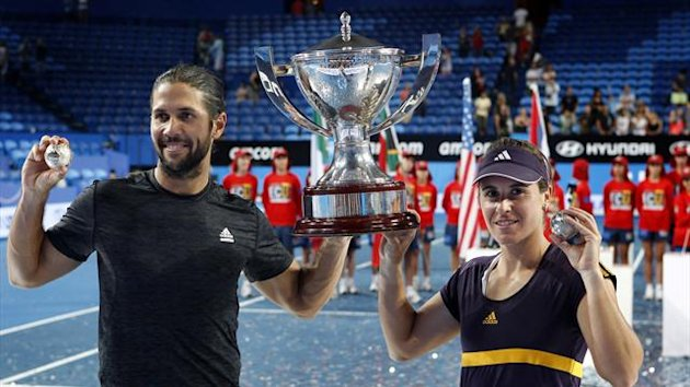 Fernando Verdasco (L) and Anabel Medina Garrigues of Spain hold up the Hopman Cup and their diamond encrusted silver tennis balls after defeating Novak Djokovic and Ana Ivanovic of Serbia