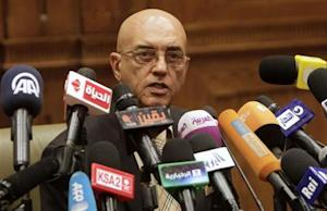 Constituent Assembly spokesman Mohamed Salmawy speaks at a news conference at the Shura Council in Cairo