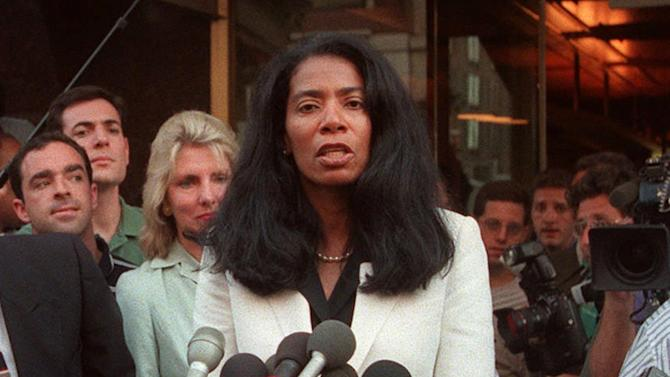 """FILE - In this Aug. 6, 1998 file photo, Members of the media surround Monica Lewinsky's spokeswoman Judy Smith outside Lewinsky's lawyers office in Washington. Staffers for embattled District of Columbia Mayor Vincent Gray have sought out Smith, a crisis-management expert who advised Monica Lewinsky and inspired the television drama """"Scandal,"""" according to emails obtained by The Associated Press. (AP Photo/Khue Bui)"""