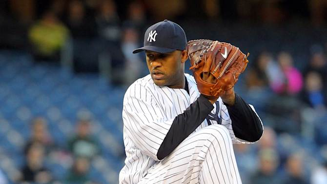 May 3, 2013; Bronx, NY, USA; New York Yankees starting pitcher CC Sabathia (52) pitches against the Oakland Athletics during the first inning of a game at Yankee Stadium. (Brad Penner-USA TODAY Sports)