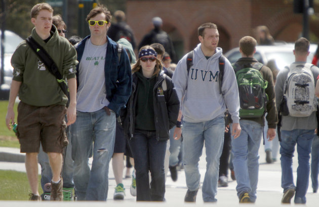 FILE-In this April 30, 2012, file photo, students walk across campus at the University of Vermont in Burlington, Vt. The sticker price of in-state tuition at four-year public universities climbed about $400 this fall, an increase of nearly 5 percent that brought the average to $8,655. That&#39;s a modest increase compared to recent years but still painful for families with stagnant incomes after a prolonged economic slump. New Hampshire and Vermont have the highest published in-state tuition charges, at around $14,000 each. Wyoming has the lowest at $4,287, followed by Utah at $5,595.(AP Photo/Toby Talbot)
