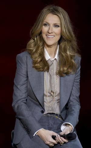 FILE - In this Tuesday March 15, 2011 file photo, Celine Dion answers questions during a press conference after her opening night performance at Caesar's Palace in Las Vegas. Singer Celine Dion has canceled several upcoming concerts in Las Vegas because of a virus. (AP Photo/Julie Jacobson, File)