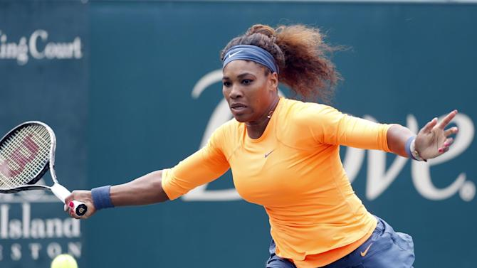 Serena Williams returns to Mallory Burdette at the Family Circle Cup tennis tournament in Charleston, S.C., Friday, April 5, 2013. (AP Photo/Mic Smith)
