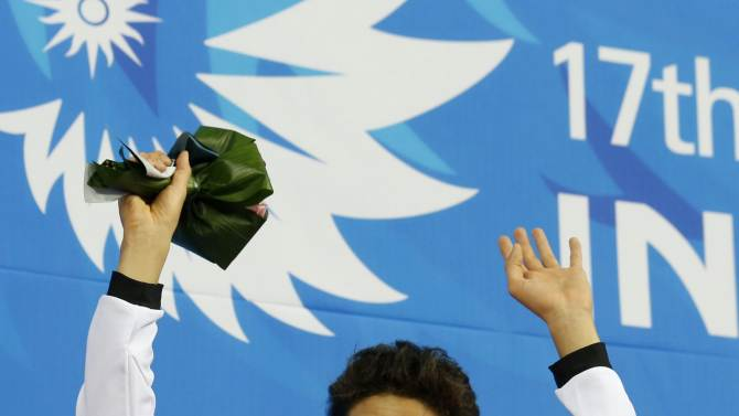 Silver medallist Kosuke Hagino of Japan gestures after the men's 400m freestyle final swimming competition in Incheon