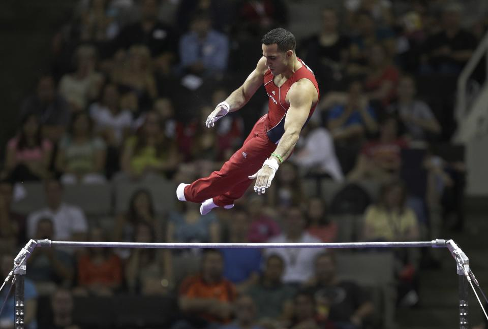 Danell Leyva competes on the horizontal bar during the final round of the men's Olympic gymnastics trials, Saturday, June 30, 2012, in San Jose, Calif. (AP Photo/Jae C. Hong)