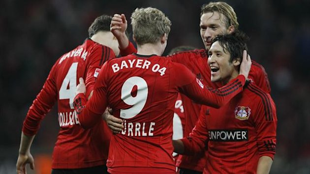 Bayer Leverkusen's Andre Schuerrle (#9) celebrates with team mates (L-R) Philipp Wollscheid, Simon Rolfes and Hajime Hosogai after scoring a goal against Schalke 04 during their first division Bundesliga match in Leverkusen November17, 2012.