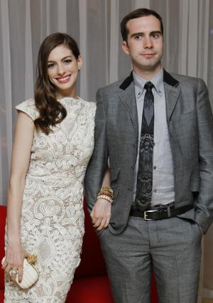 "FILE - In this Aug. 23, 2011 file photo, U.S actress Anne Hathaway and Adam Shulman arrive at the afterparty at The Sanderson hotel in central London for the European Premiere of ""One Day."" Publicist Stephen Huvane confirmed Monday, Nov. 28, that the Oscar-nominated actress and Shulman are engaged. (AP Photo/Joel Ryan, file)"