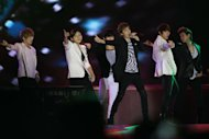 Kpop group &quot;UKISS&quot; performs for the crowd during the &quot;Dream Kpop Fantasy Concert&quot; held at the Mall of Asia grounds in Pasay city, south of Manila on 19 January 2013.  (George Calvelo/NPPA Images)