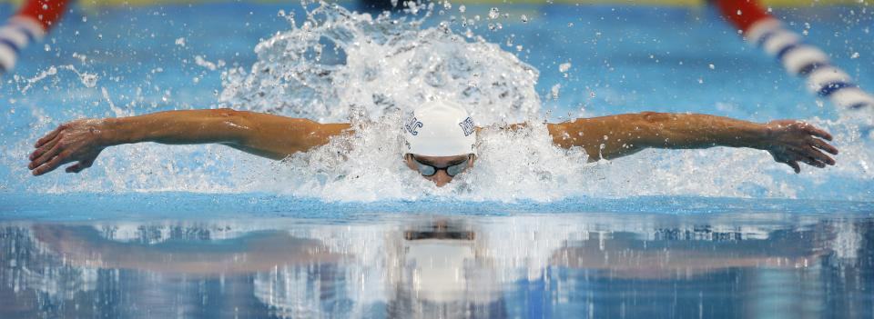 Michael Phelps swims to victory in the men's 100-meter butterfly final at the U.S. Olympic swimming trials, Sunday, July 1, 2012, in Omaha, Neb. (AP Photo/Mark Humphrey)