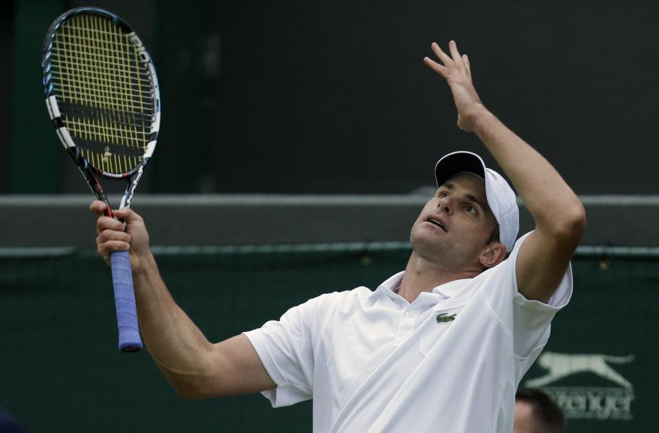Andy Roddick of the United States plays a return during a first round men's singles match against Jamie Baker of Britain at the All England Lawn Tennis Championships at Wimbledon, England, Tuesday, June 26, 2012. (AP Photo/Tim Hales)