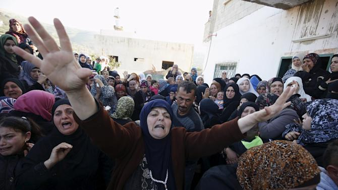Relative of Palestinian teenager Nihad Waked, 15, who was shot dead by Israeli troops on Sunday, reacts during his funeral near the West Bank city of Jenin