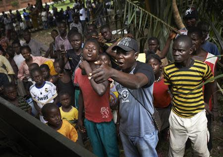 People protest during a religious reconciliation tour in the outskirts of Bangui