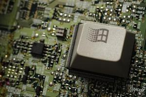 An old 'graphic sign of Windows, Microsoft operating system,' key from a computer keyboard is placed on plate of integrated circuit is seen in this illustration picture taken in Warsaw